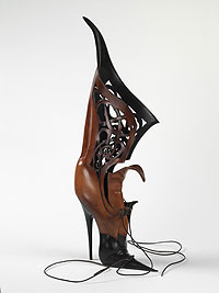 Bramble Boot. Artist Garry Greenwood's treatment of the leather, a process of wet-forming, laminating, burnishing and polishing techniques, transforms the sculpture into what looks like a wood finish.