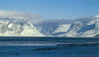 Landscape photograph of the mountainous terrain of the Pangnirtung Fiord.